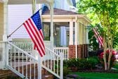 126938972-american-flags-on-front-porches